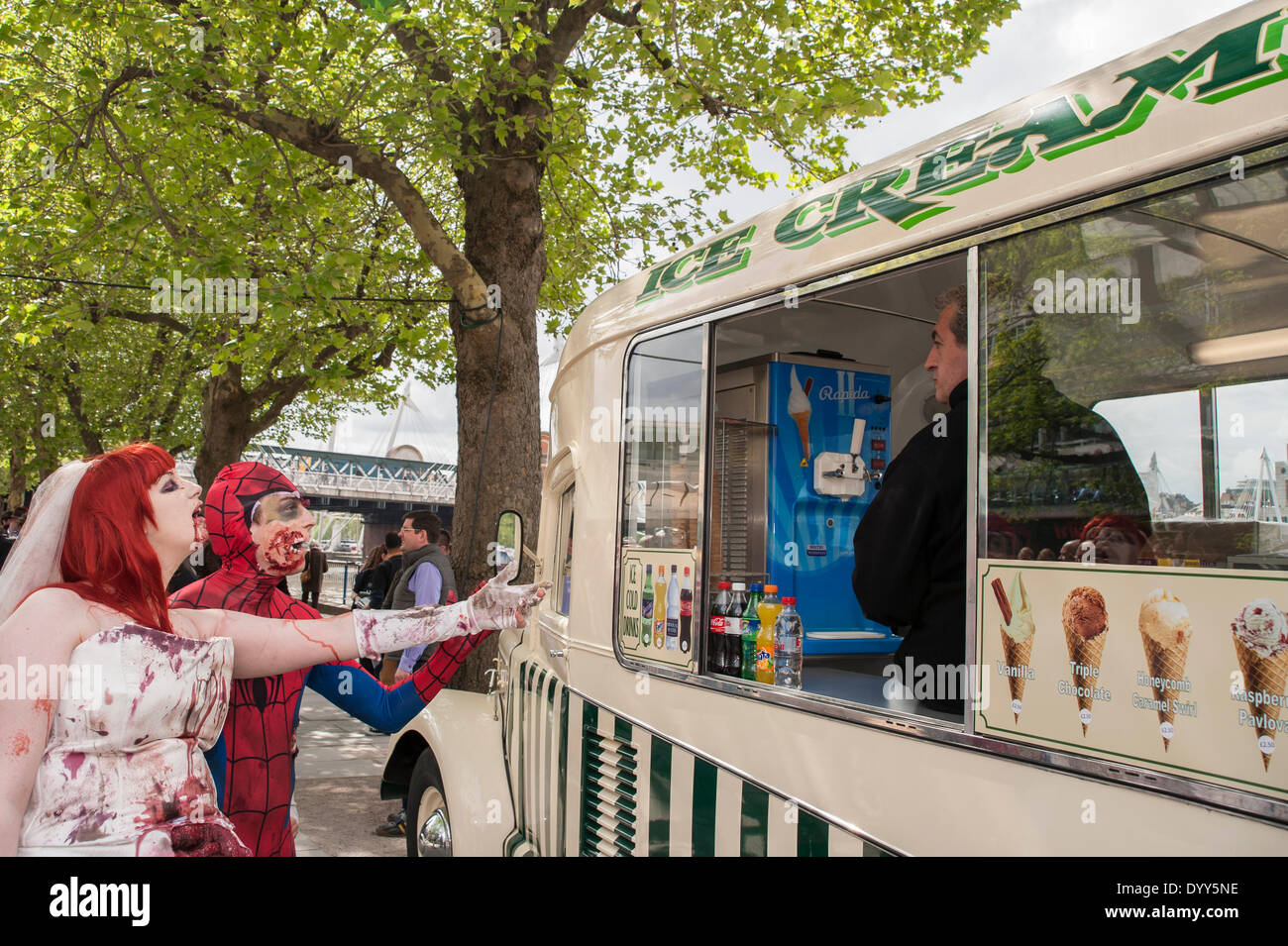 London, 27 April 2014 - people dressed as their favourite sci-fi characters take part in the Sci-Fi London 2014 costume parade starting at Somerset House and finishing at the BFI on the South Bank.  Zombie bride and zombie Spider-Man attempt to buy an ice cream.    Credit:  Stephen Chung/Alamy Live News - Stock Image