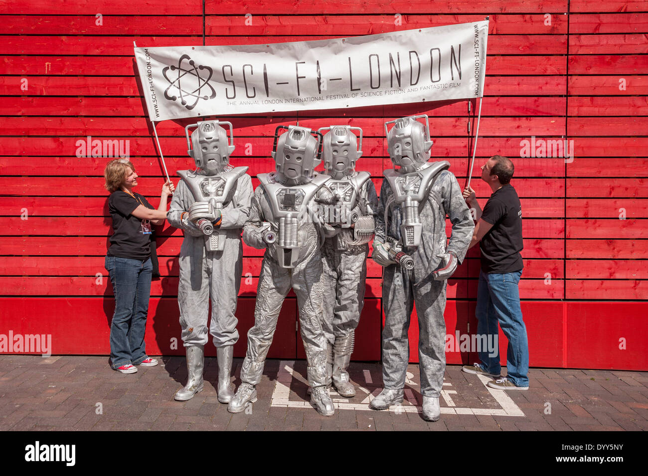 London, 27 April 2014 - people dressed as their favourite sci-fi characters take part in the Sci-Fi London 2014 costume parade starting at Somerset House and finishing at the BFI on the South Bank. People dressed as Cybermen under a Sci-Fi London banner.    Credit:  Stephen Chung/Alamy Live News - Stock Image
