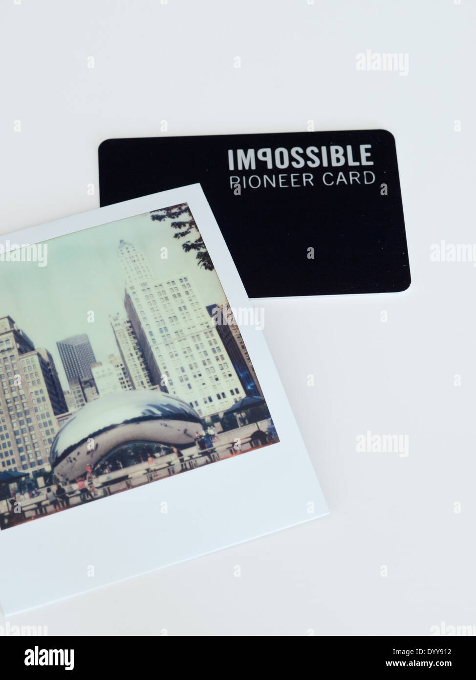 A view of an Impossible Pioneer Card and Polaroid picture (from Impossible Project film). Stock Photo
