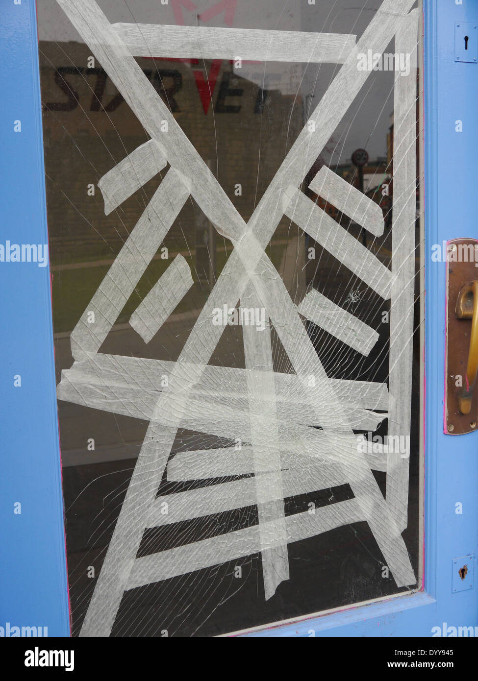 Vandalism - broken window of commercial premises, Newcastle upon Tyne, England, UK - Stock Image