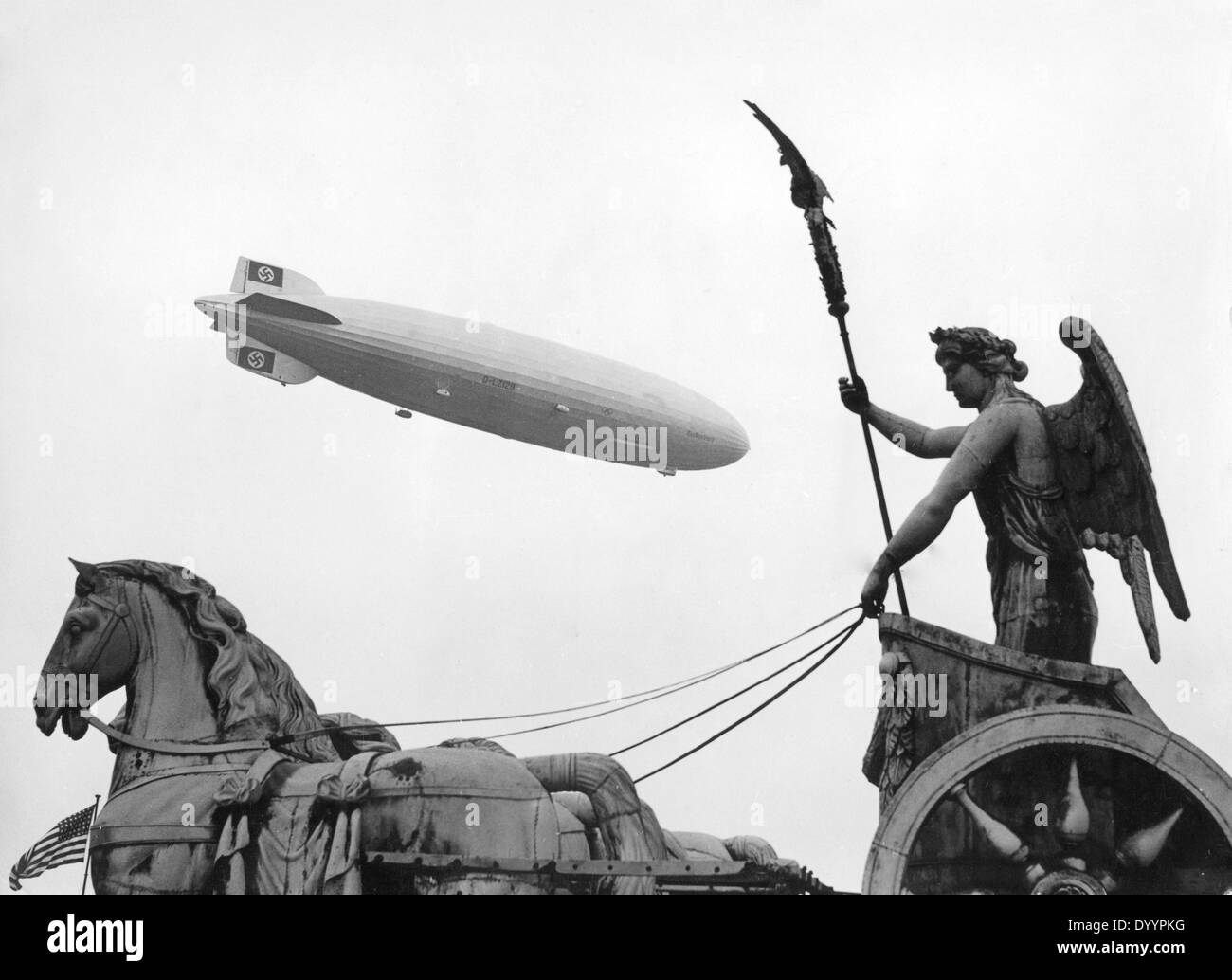 Zeppelin Hindenburg (LZ 129) and the Brandenburg Gate in Berlin during the Olympics 1936 Stock Photo