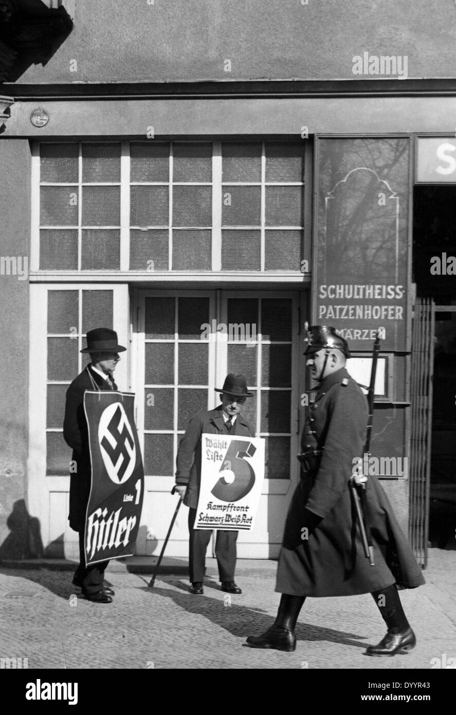 Men with election posters, 1933 - Stock Image
