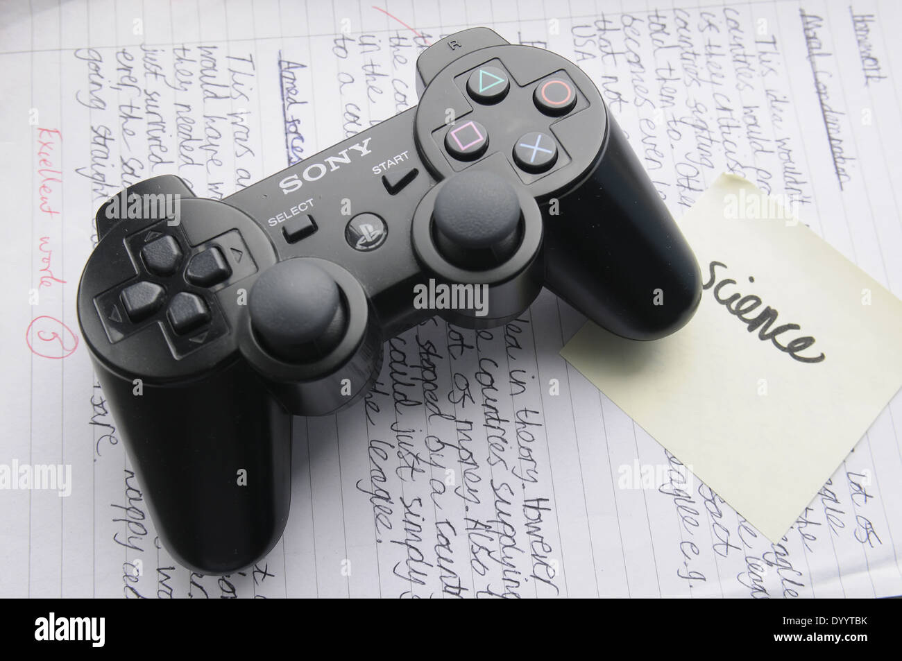 Ps2 Controller Stock Photos Images Alamy Sony Playstation 2 Game Against A Page Of Homework Image