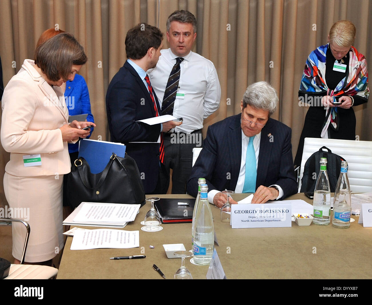 Secretary Kerry Puts Final Touches on Remarks Before News Conference in Geneva - Stock Image