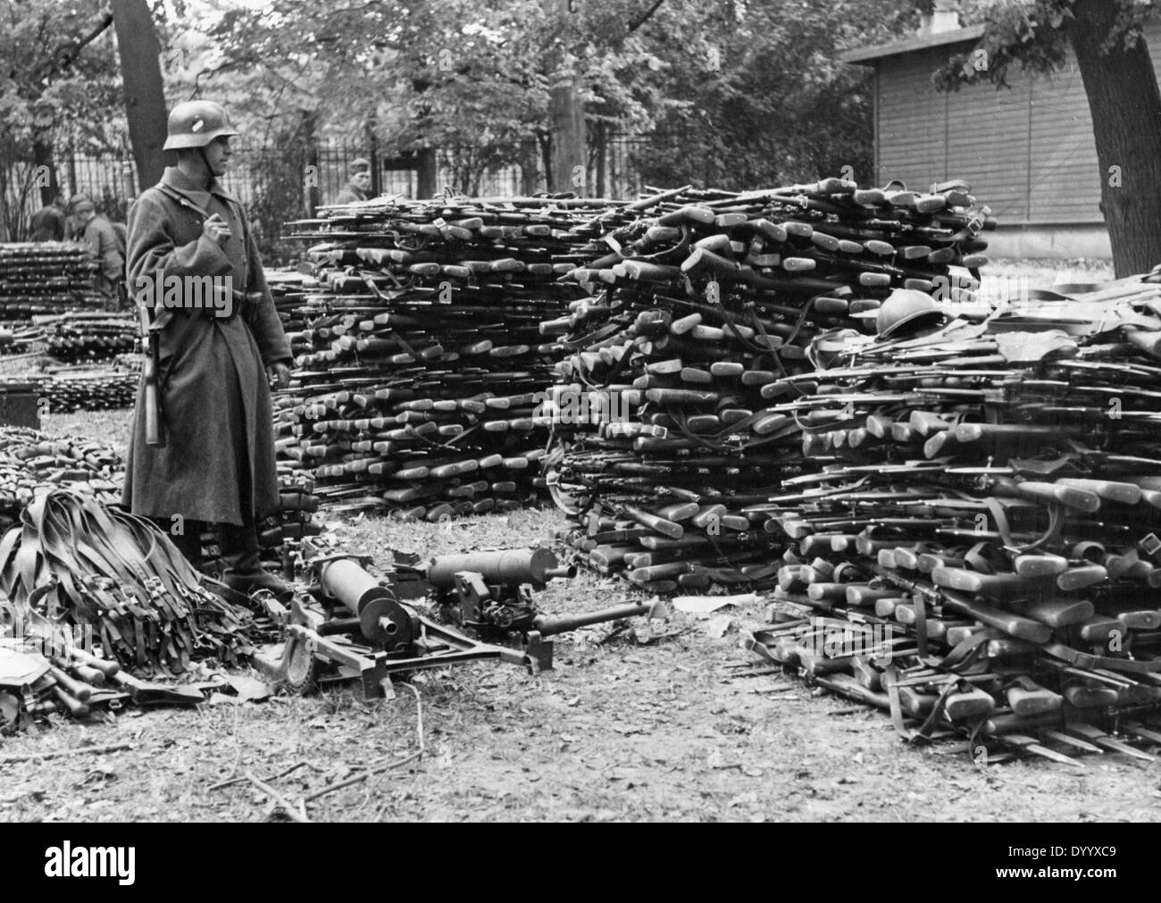 A German soldier with captured weapons, 1939 - Stock Image