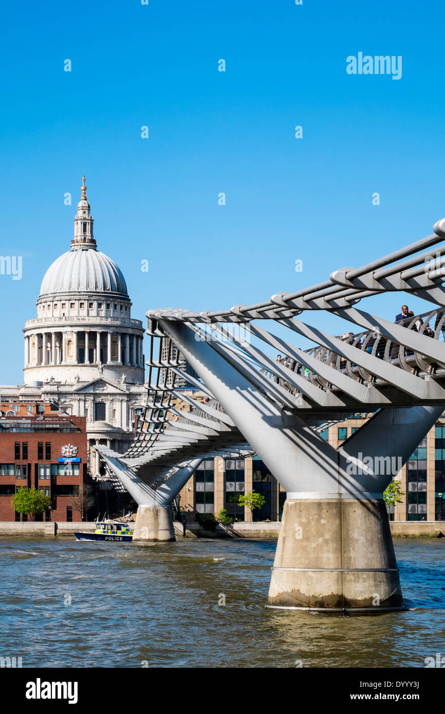 Millennium Bridge and St Paul's Cathedral in London United Kingdom - Stock Image