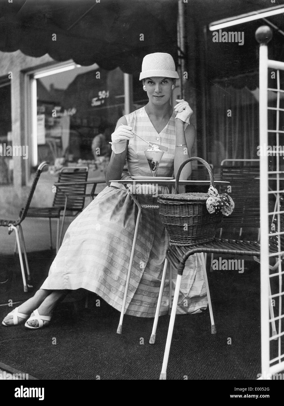 A lady in a street cafe, 1956 - Stock Image