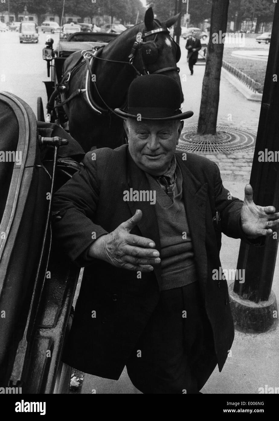 A coachman in Paris, 1958 - Stock Image