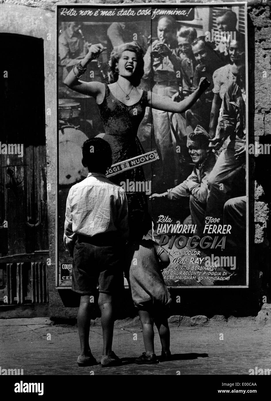 Children in front of a film poster in Rome - Stock Image