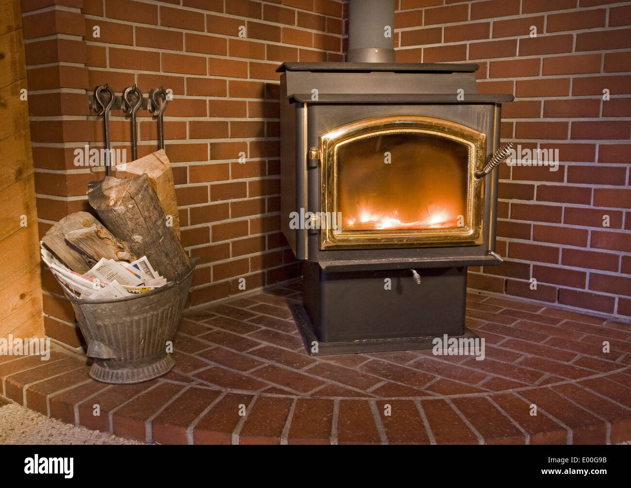Detail of a wood-burning stove in the living room of a wooden home. - Stock Image