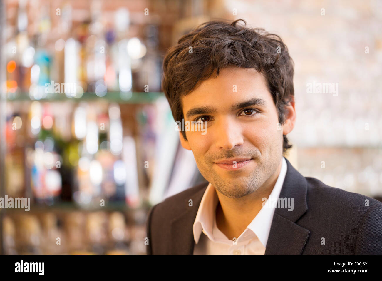 Male cheerful looking camera coffee bar - Stock Image