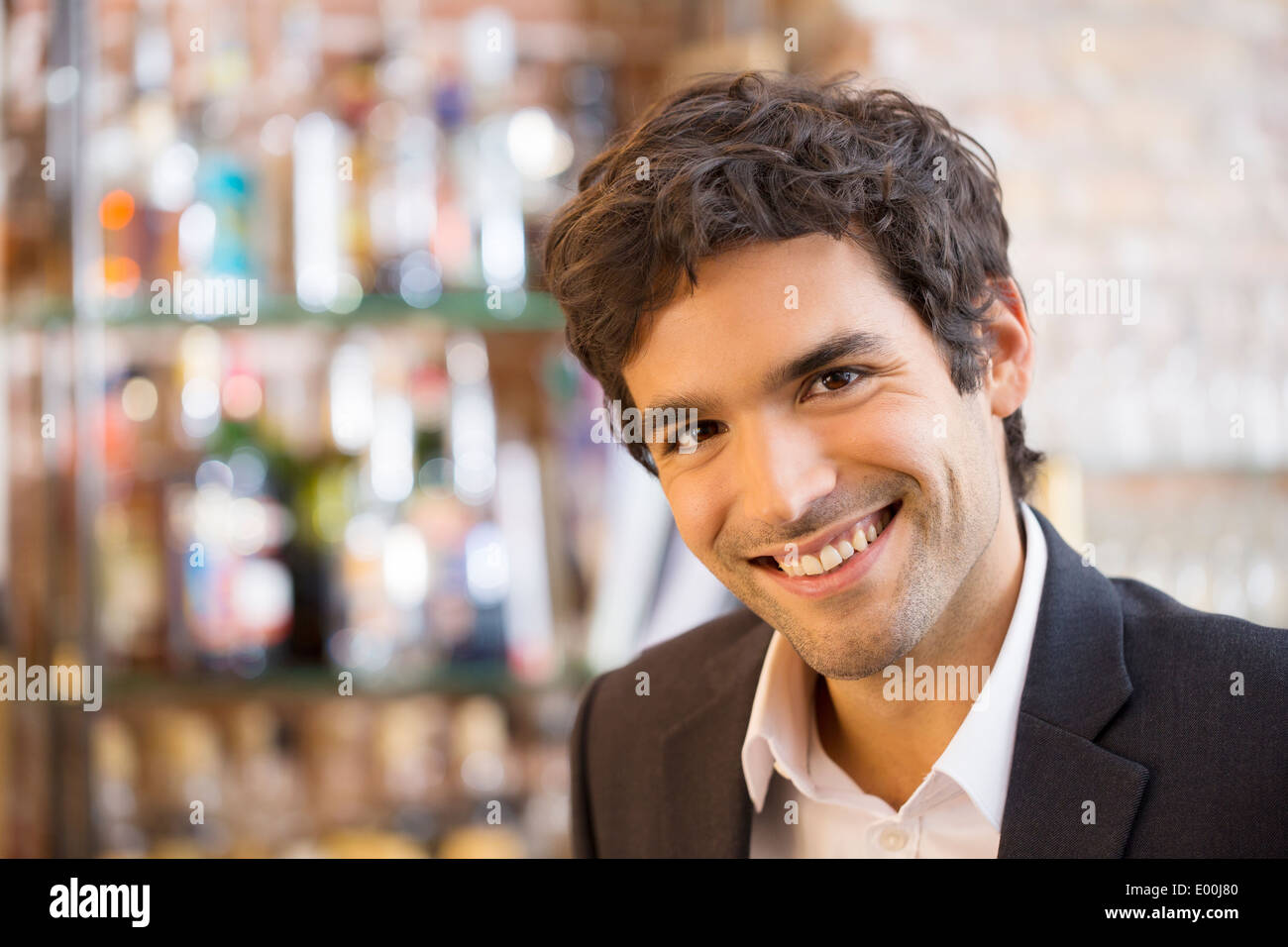 Male smiling cheerful coffee bar looking camera Stock Photo