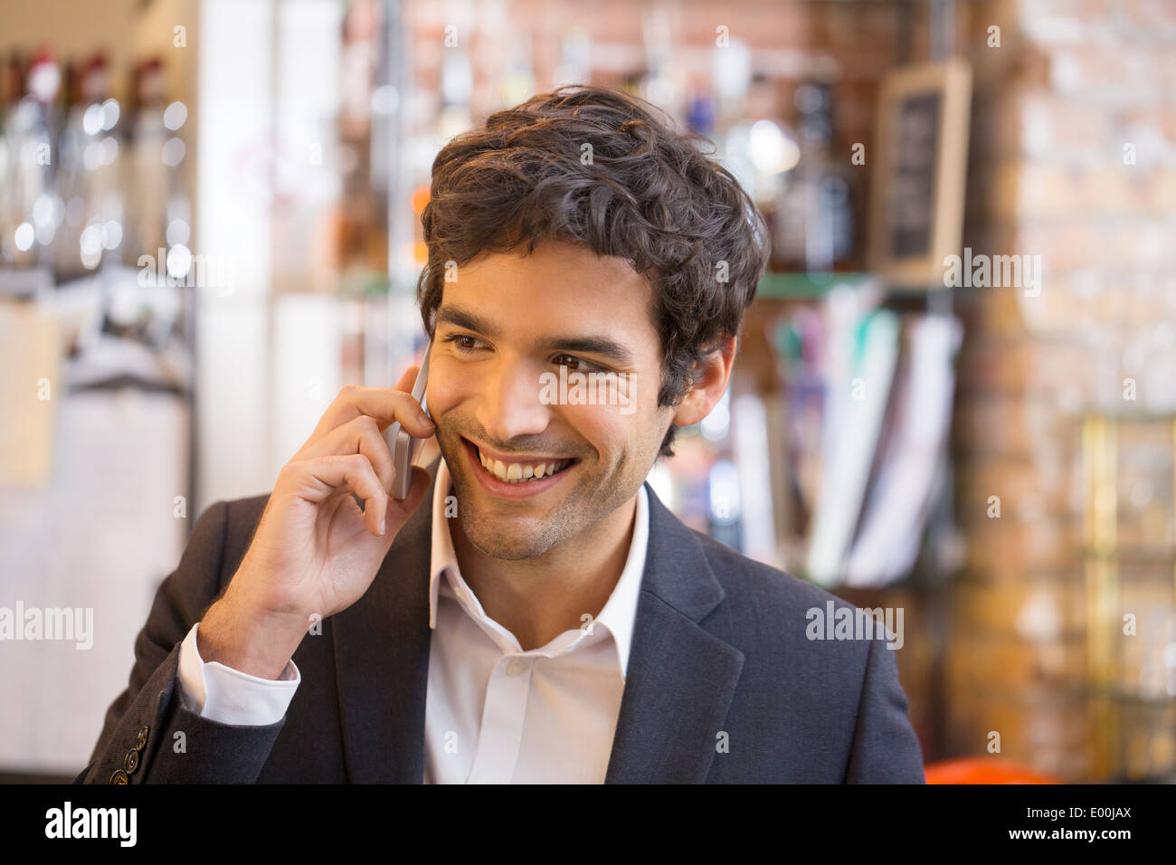 Male cheerful mobile phone smiling restaurant - Stock Image