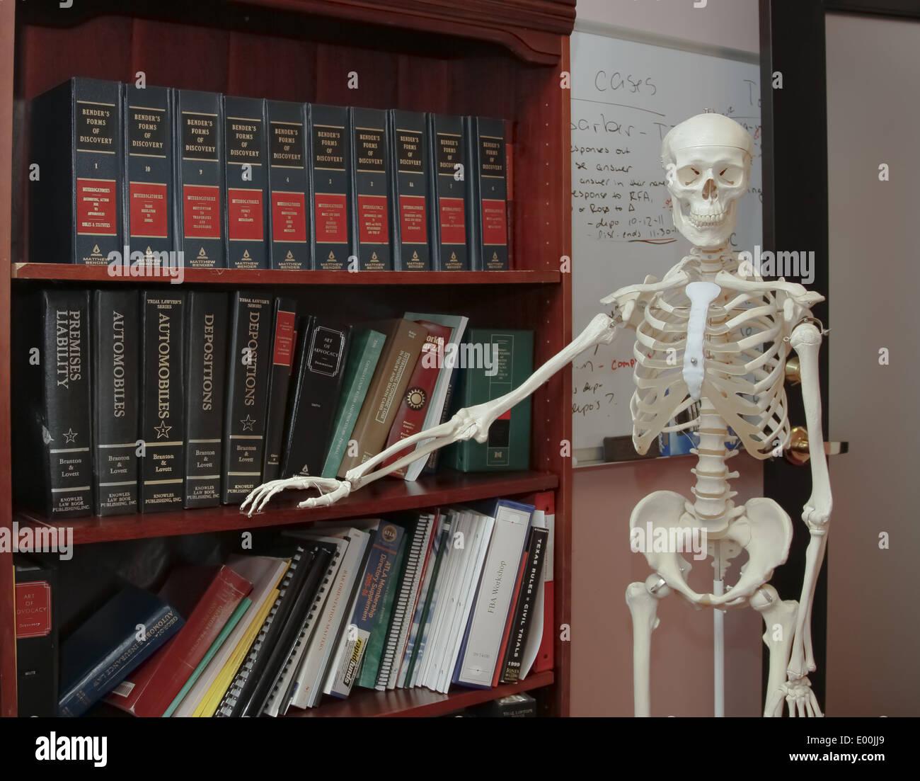 Skeleton model in posing in front of a law office bookshelf