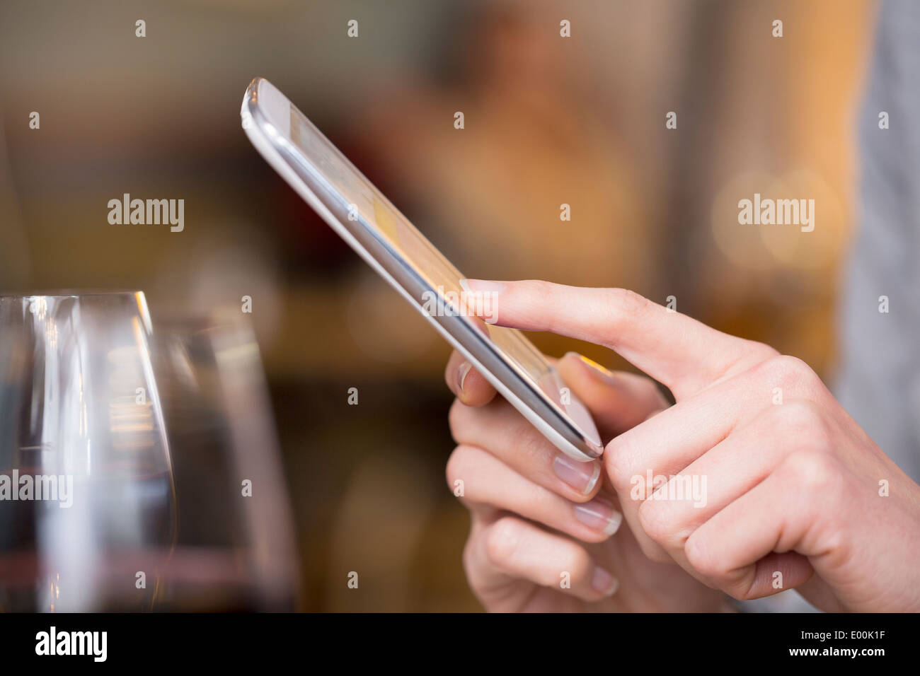 female smartphone pub texting sms fingers pub messgae e-mail - Stock Image