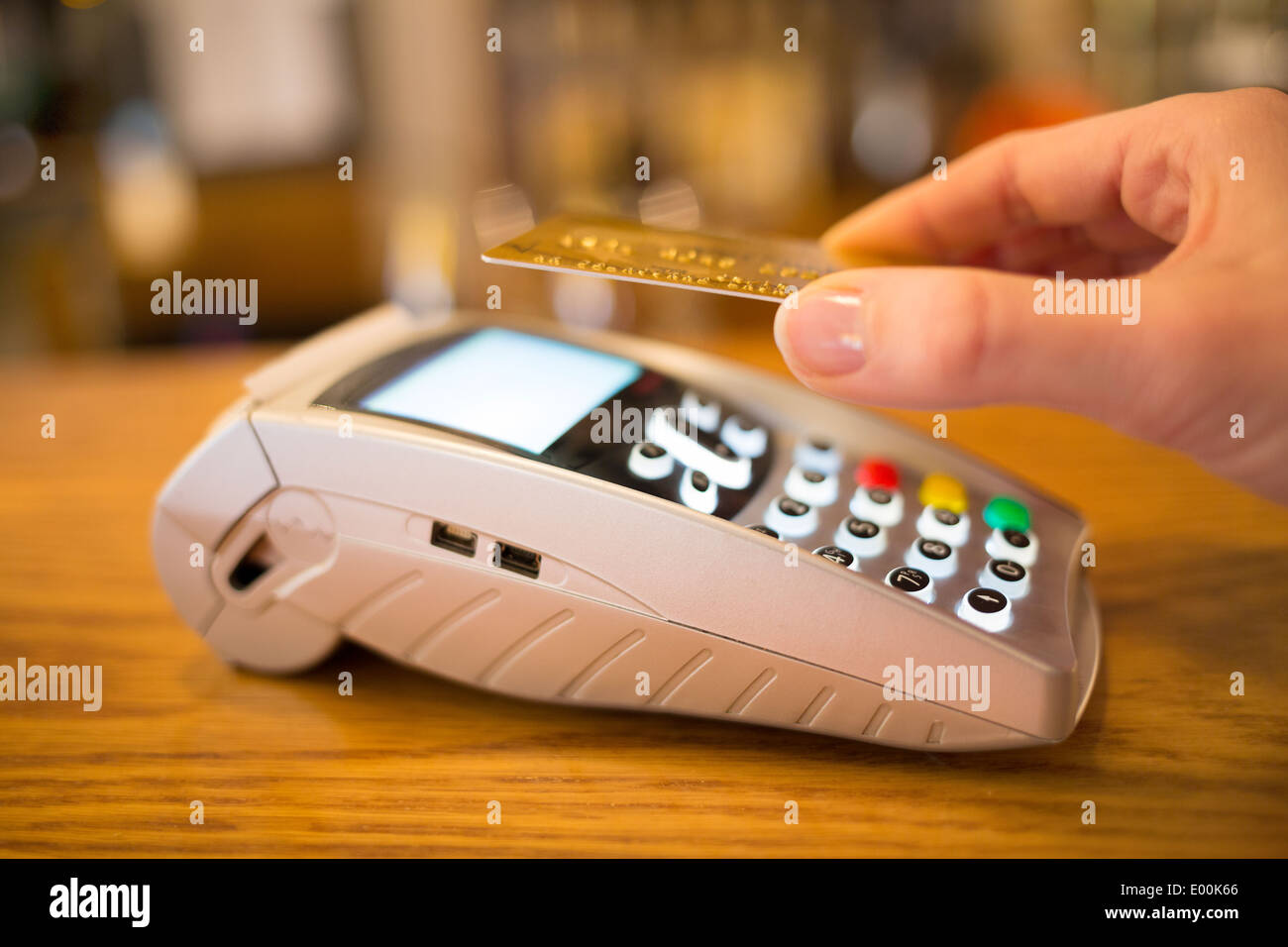 Female hand wallet payment shop - Stock Image