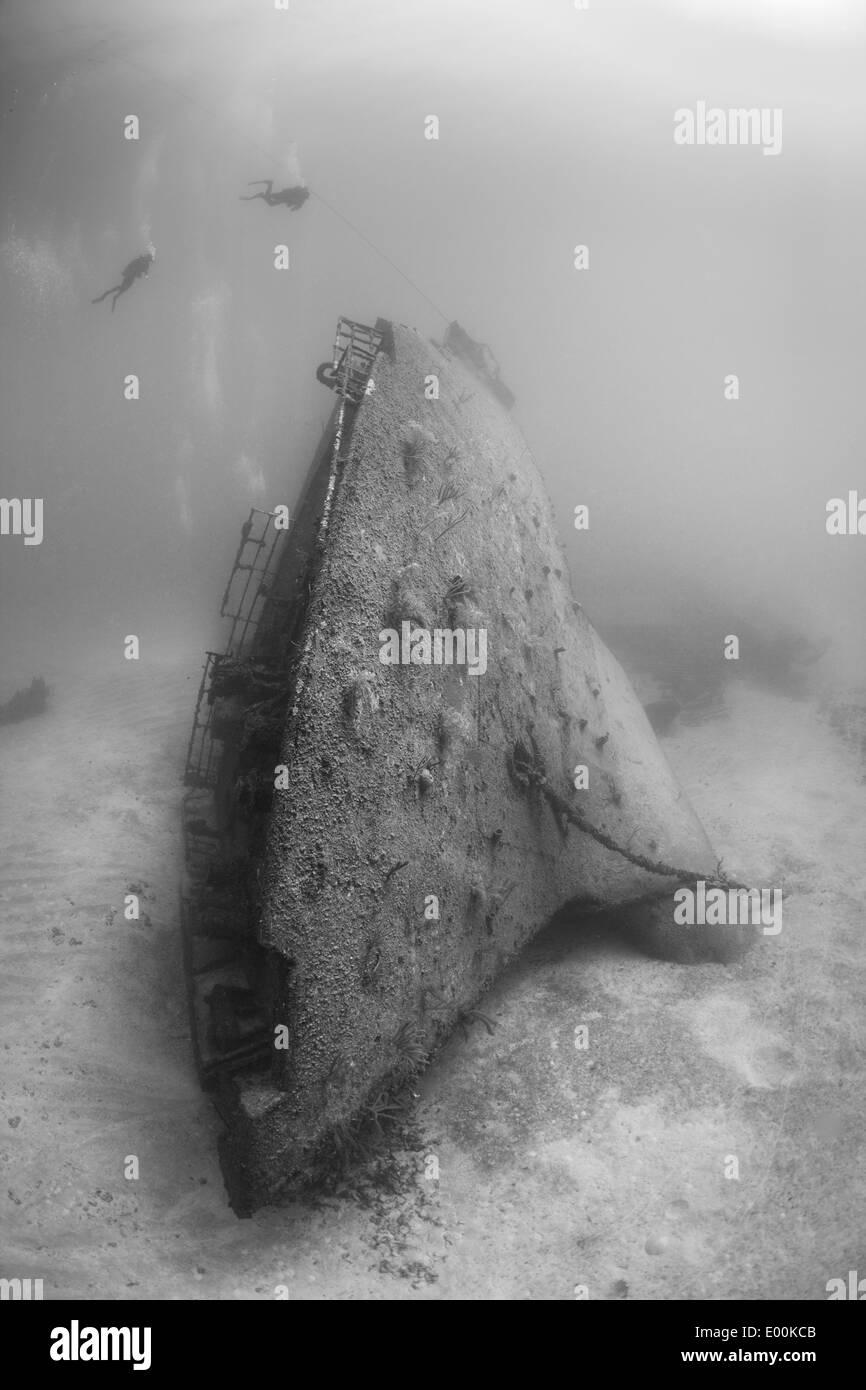 Scuba divers around the Odyssey Wreck off Roatan, Honduras. Stock Photo