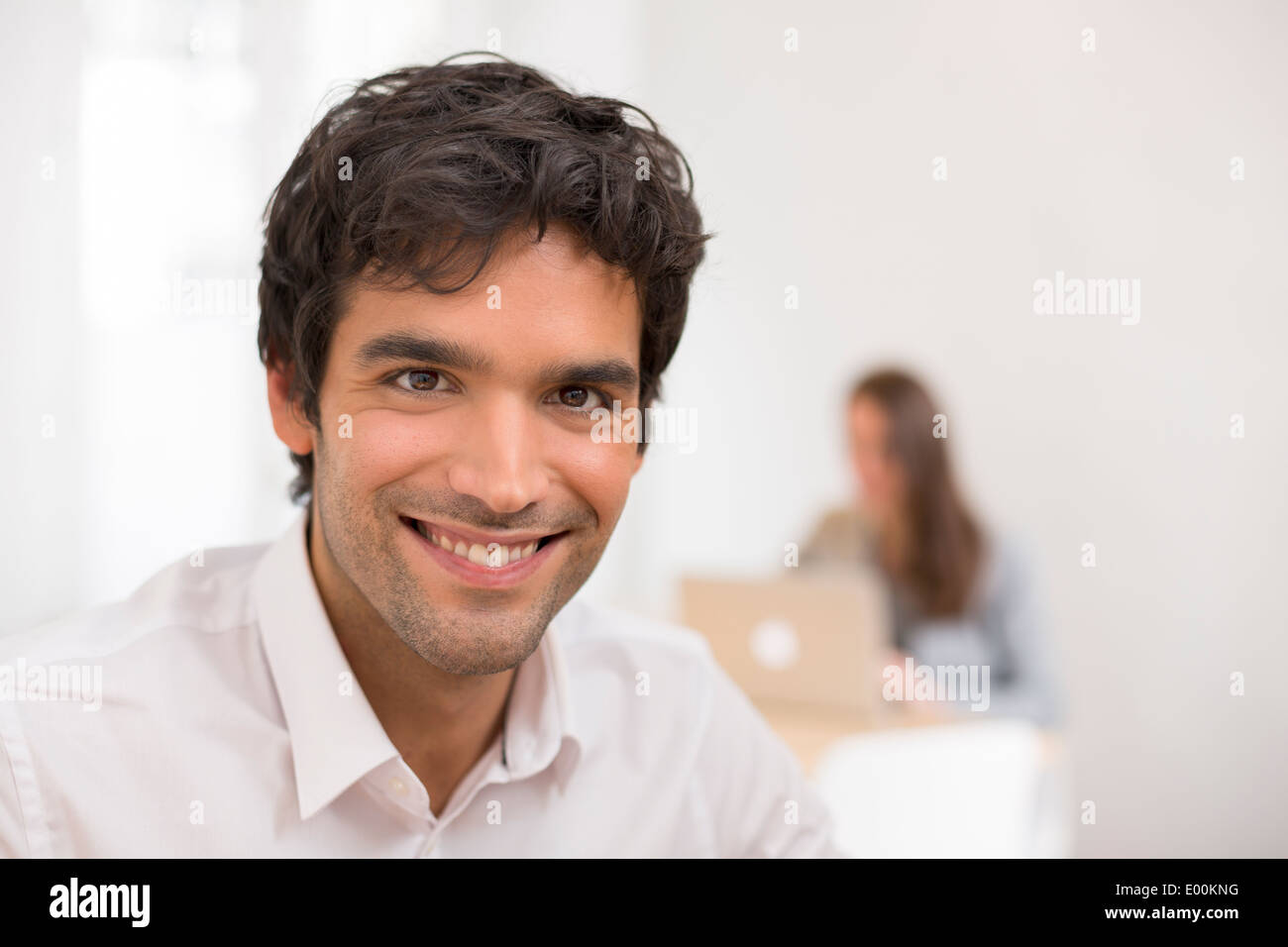 Male business handsome pc desk colleagues background - Stock Image