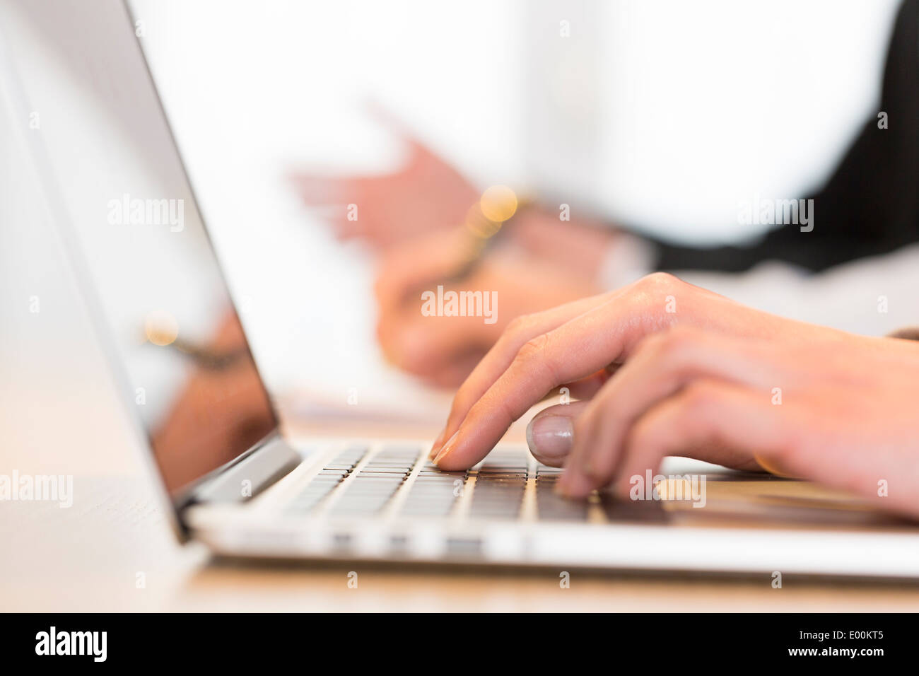 Female computer keyboard desk colleague background - Stock Image