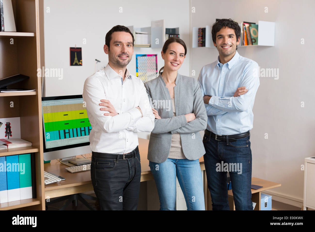 Female male desk colleagues group looking camera Stock Photo