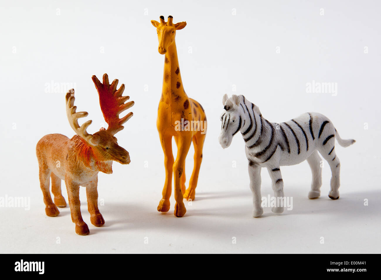 Plastic Toys And Figures From A Play Set Dinosaurs Farm Animals