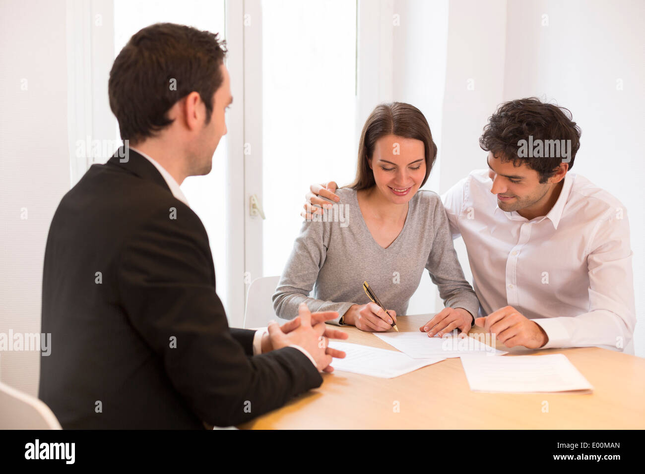 Woman man advisor office house investment - Stock Image