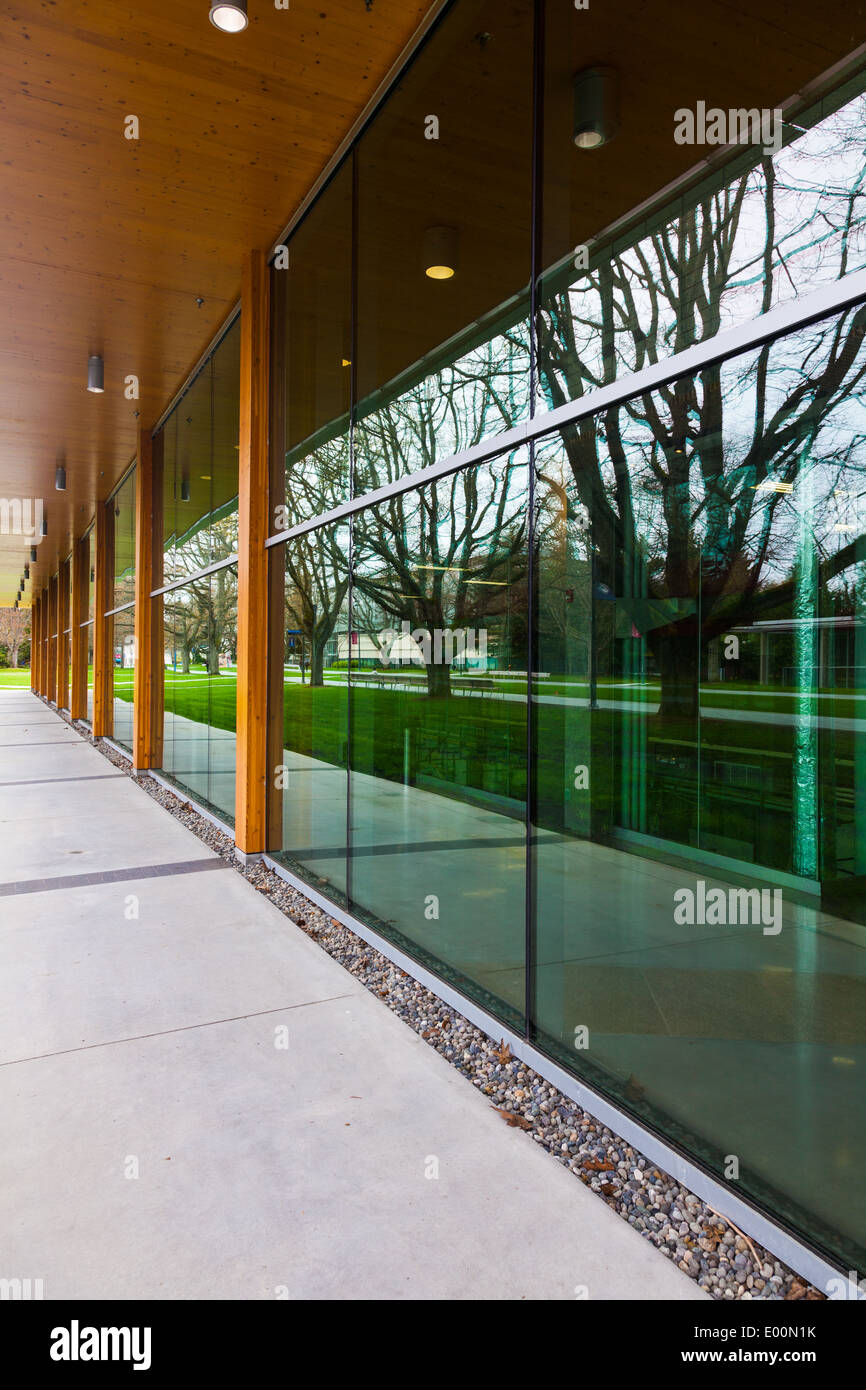 Reflective wall of glass panels on the campus of UBC, Vancouver, Canada - Stock Image