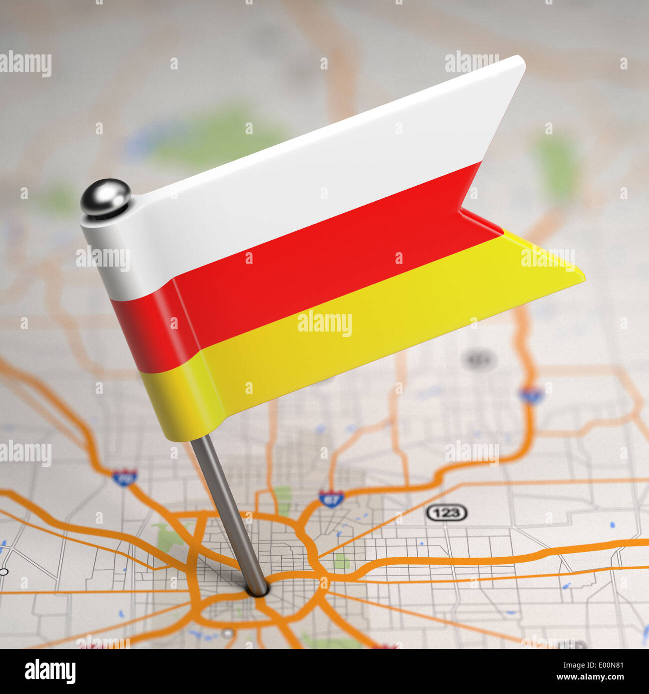 Small Flag of Republic of South Ossetia on a Map Background with Selective Focus. - Stock Image