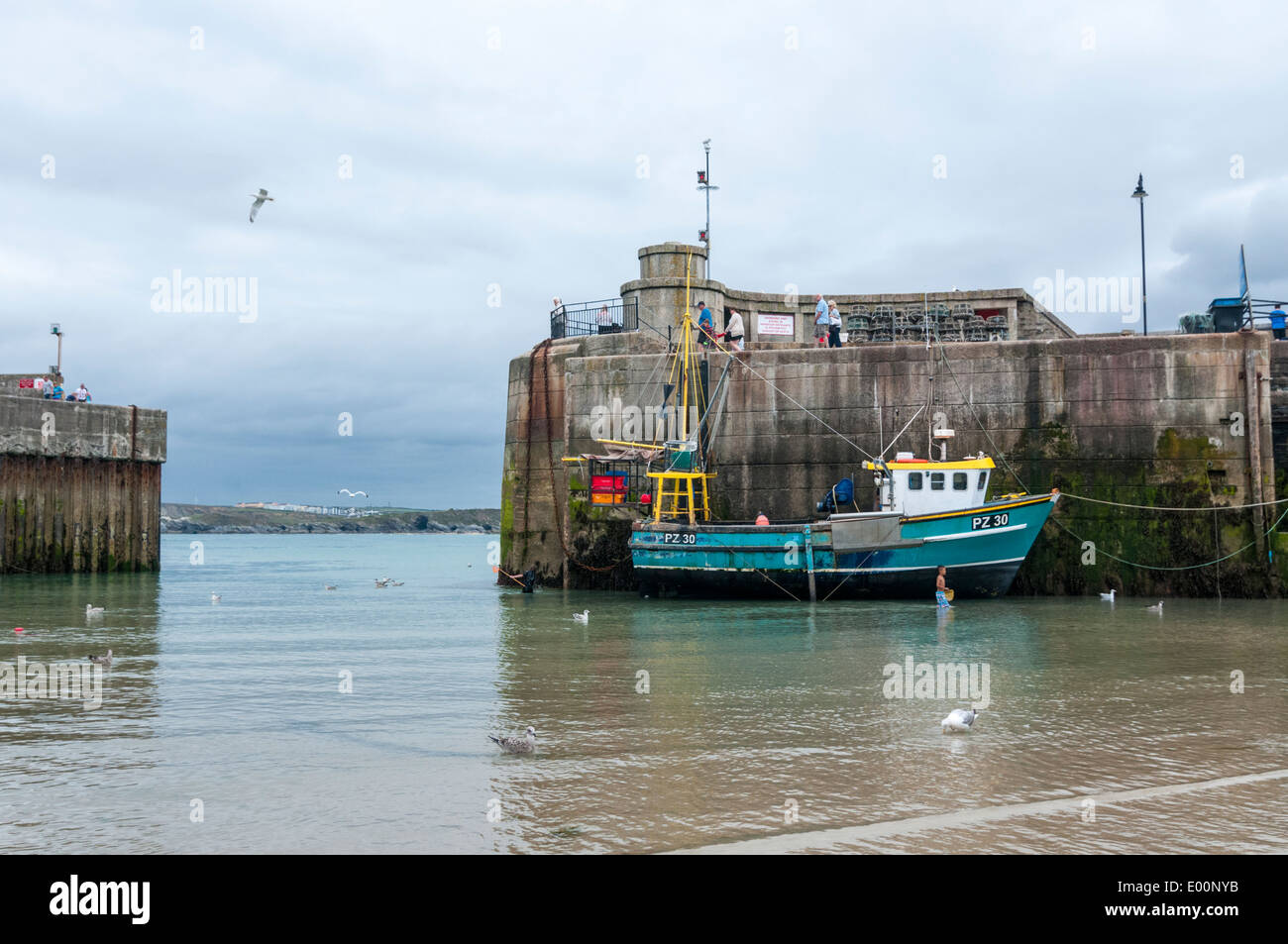 A single fishing moored inside Newquay harbour - Stock Image