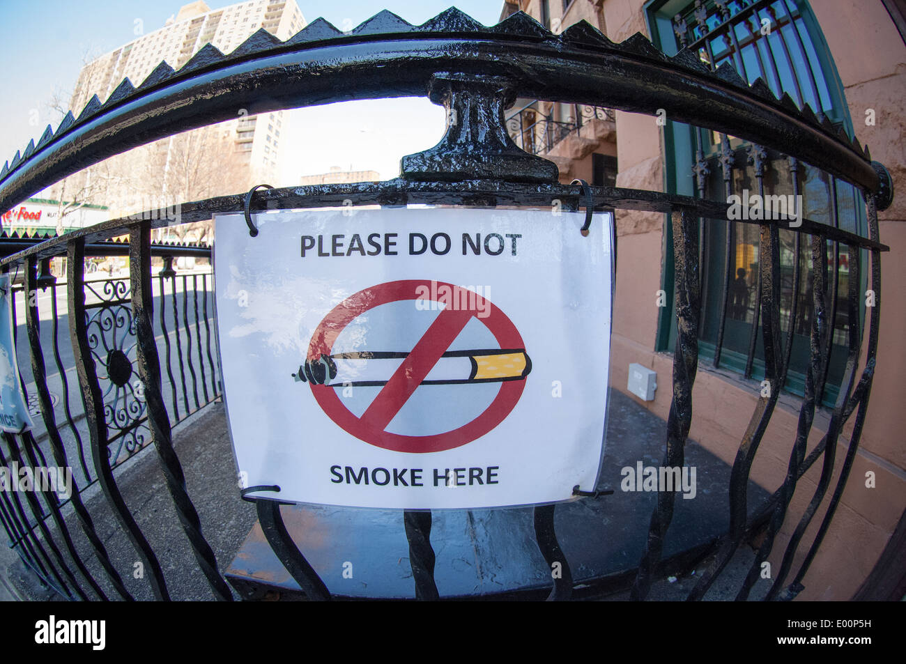 A No Smoking sign on a fence in the Clinton Hill neighborhood in Brooklyn in New York - Stock Image