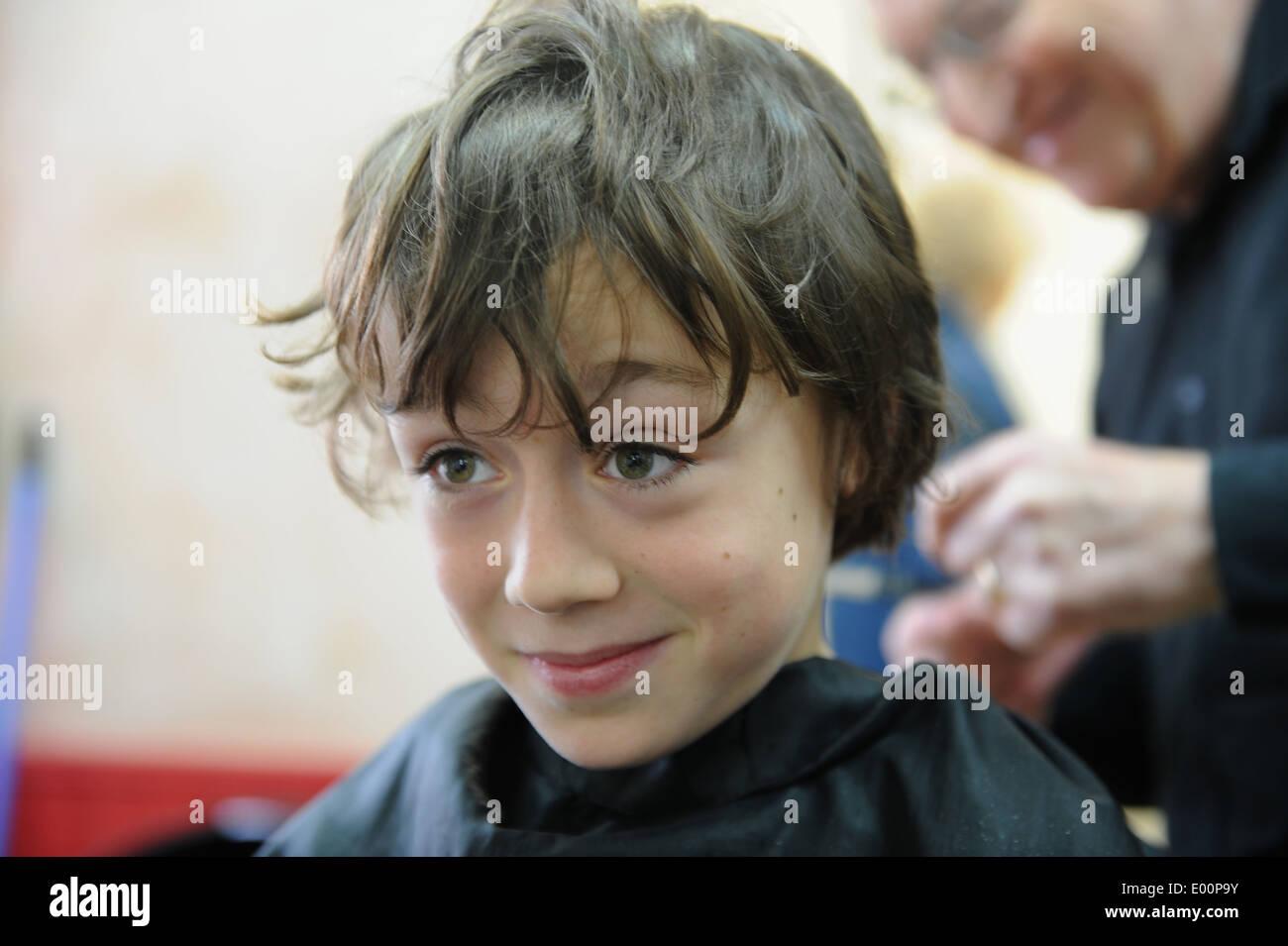 9 Year Old Schoolboy Having A Haircut In Barbers In Great Ayton