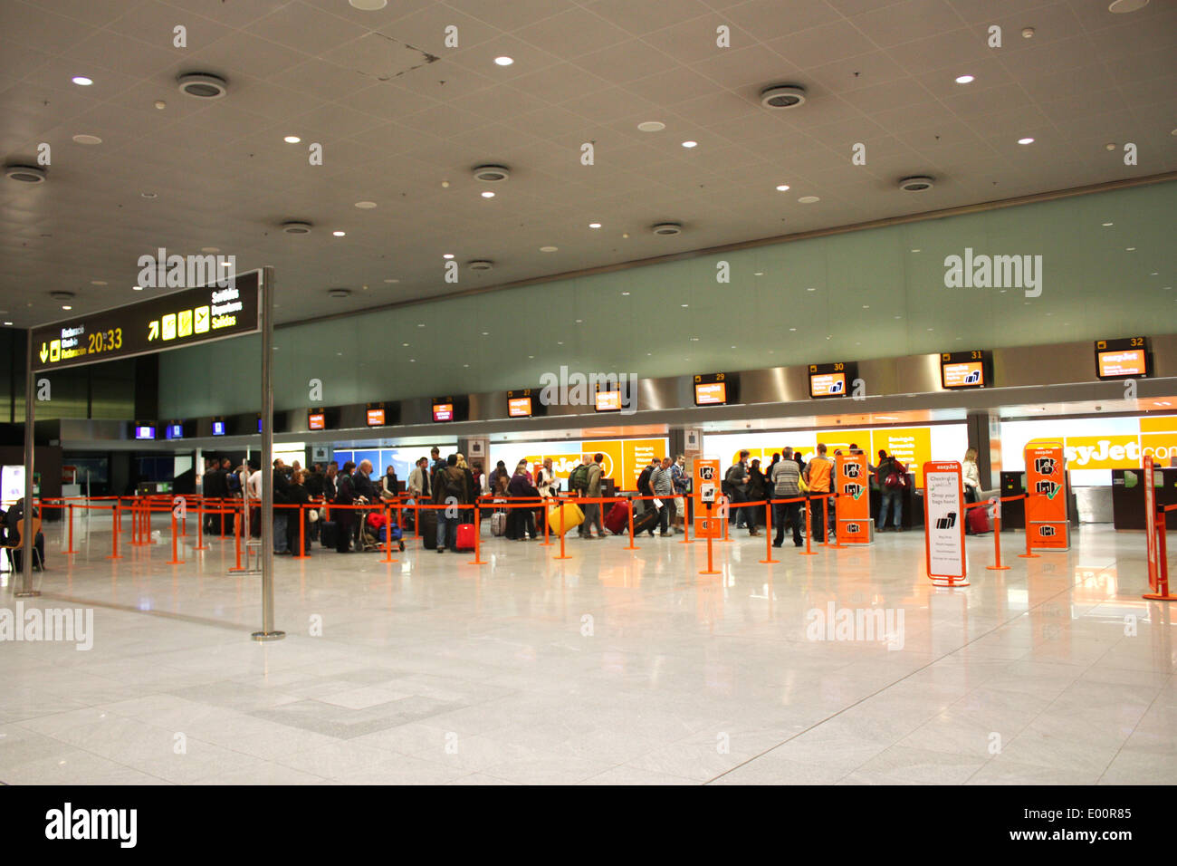 Check in counters at Barcelona airport - Stock Image