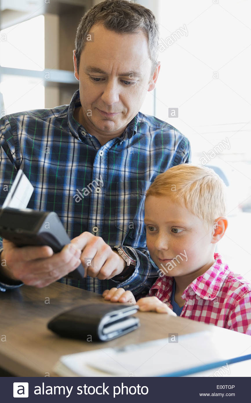 Man using credit card reader at dentists office Stock Photo