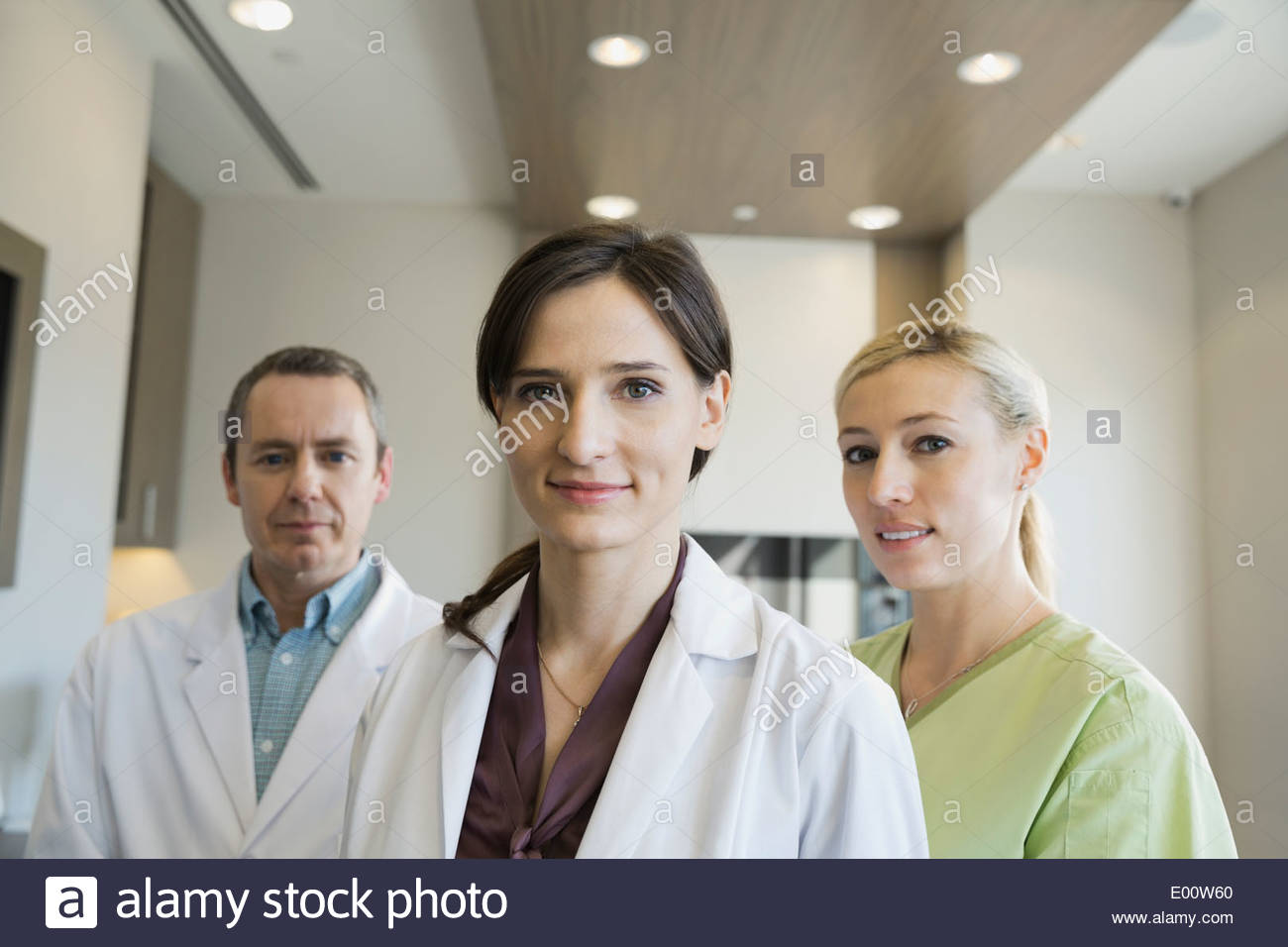 Portrait of confident dentists and assistant - Stock Image