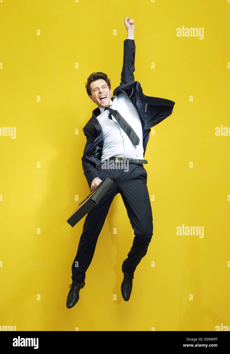 Handsome successful businessman in the victory jump - Stock Image