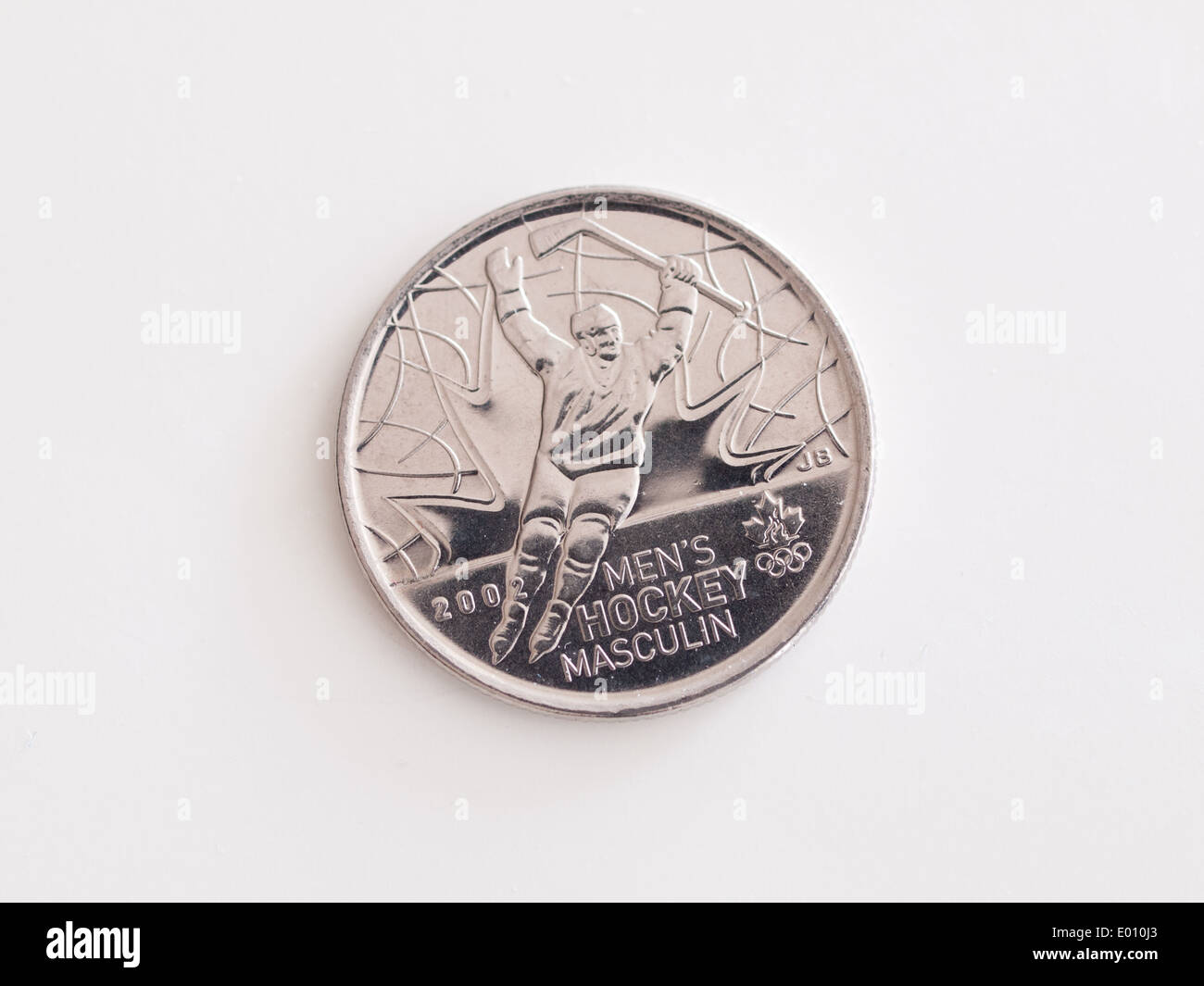 A Canadian quarter (25-cent coin) depicted Canada's 2002 Olympic gold in Men's Hockey. - Stock Image