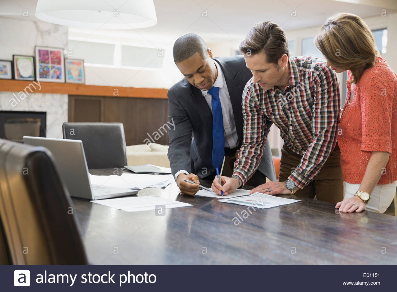 Couple signing documents for financial advisor Stock Photo