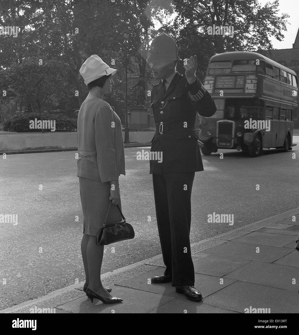 Woman and policeman in London, 1964 - Stock Image