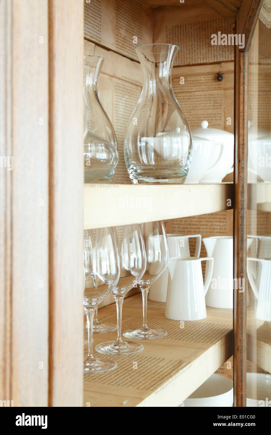 Detail Of Rustic Cabinet Displaying Glassware And Crockery Interior Of  Cabinet Lined With Pages Of A