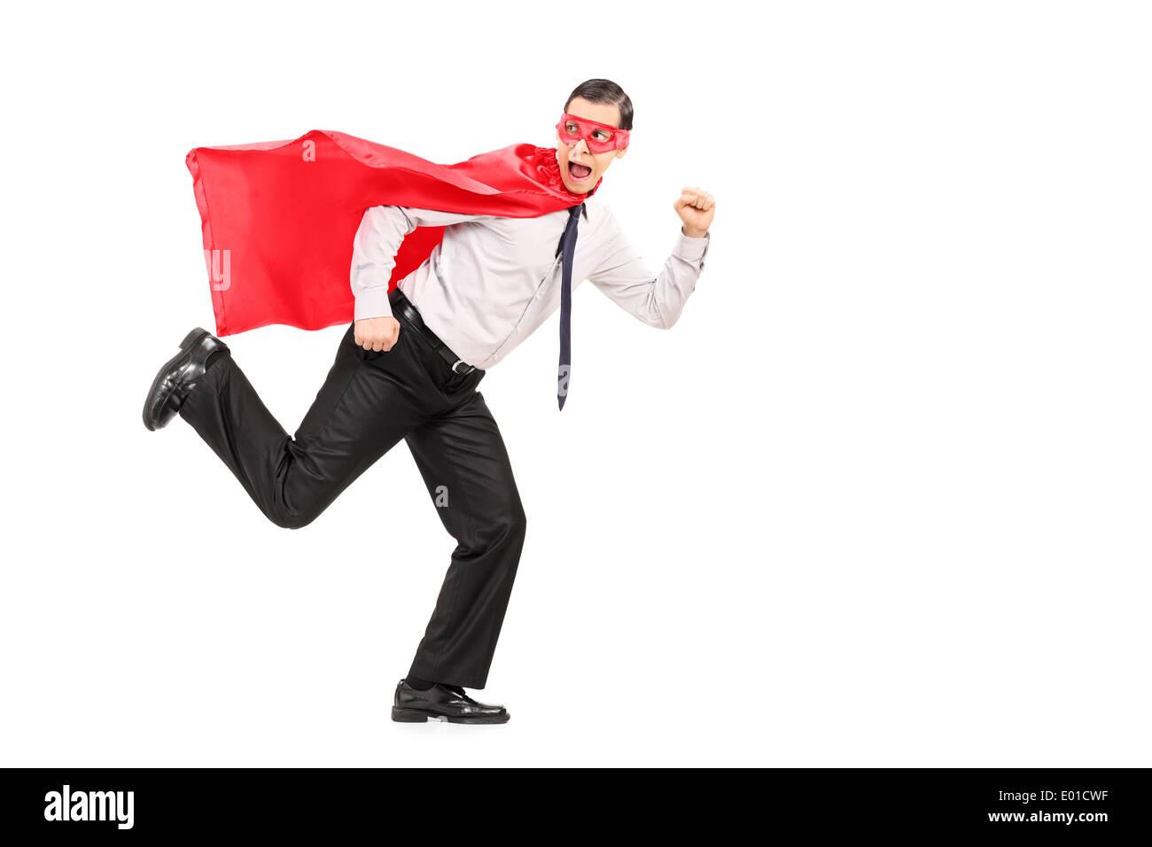 Scared man in superhero costume running away from something Stock Photo