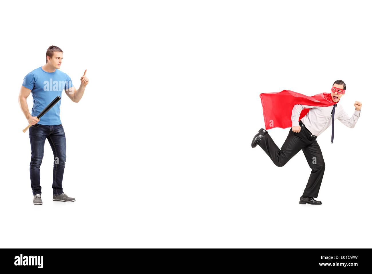 Scared superhero running away from a man with bat Stock Photo