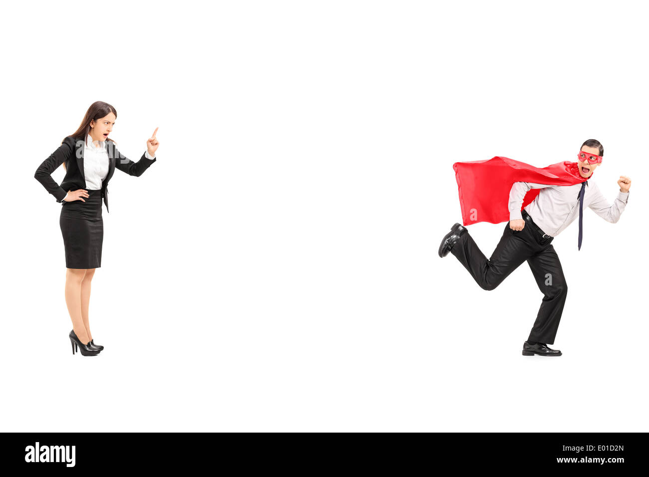 Superhero running away from an angry businesswoman Stock Photo