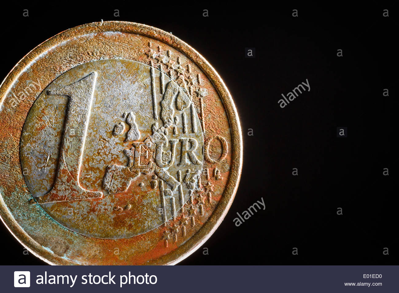 Rusty one-euro coin - Stock Image