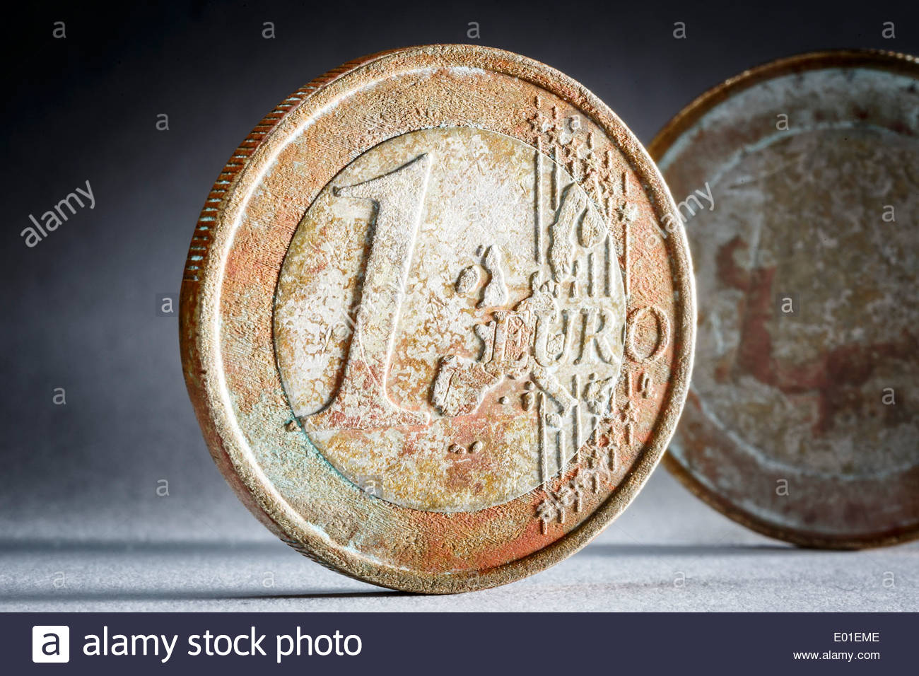 Rusty one-euro coins - Stock Image
