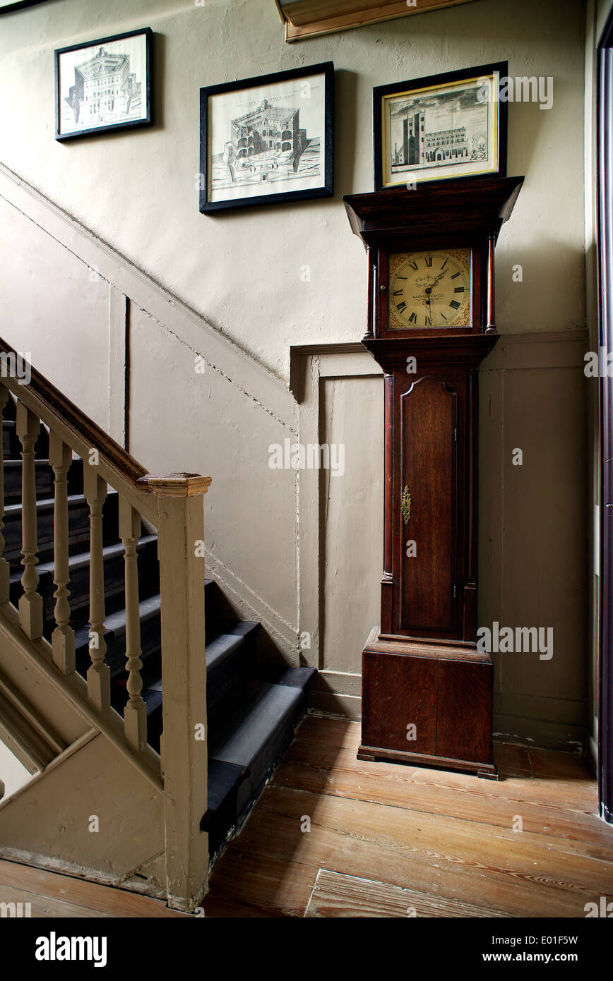 First floor landing, long case clock on the landing by the staircase. - Stock Image