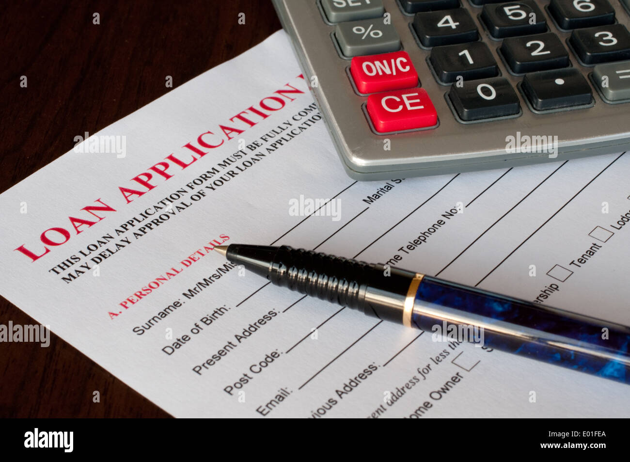 Loan application form with pen and calculator Stock Photo