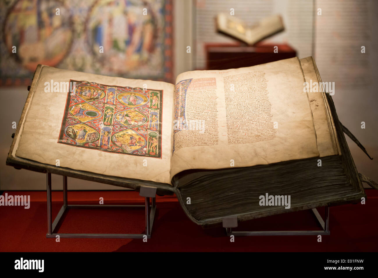 Nuremberg, Germany. 28th Apr, 2014. The so-called 'Gumbertus' Bible' is on display at the Germanisches Nationalmuseum in Nuremberg, Germany, 28 April 2014. The bible from the 12th century AD is one of the most magnificent manuscripts of the High Middle Ages. The exhibition 'The Gumbertus's Bible. Golden pictorial splendour of the Romanesque Era' continues till 27 July 2014. Photo: Daniel Karmann/dpa/Alamy Live News - Stock Image