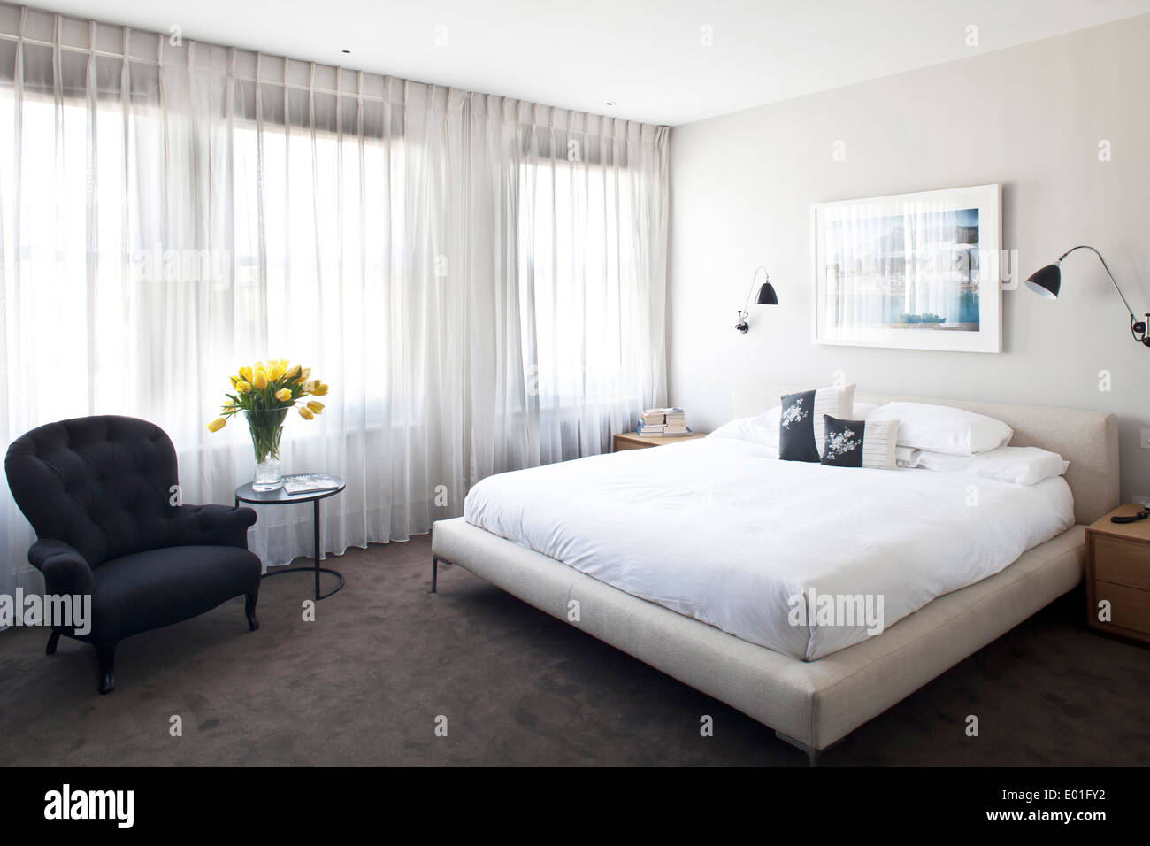 Double bed in modern white bedroom, Fulham town house, London Stock ...