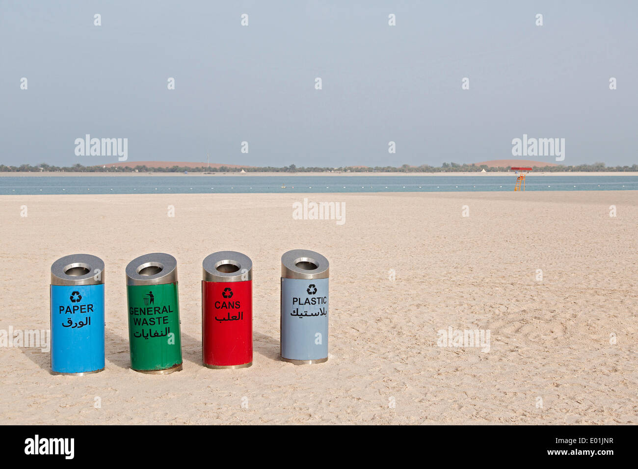Rubbish bins for sorting waste on the beach at Corniche Road, Abu Dhabi, United Arab Emirates - Stock Image