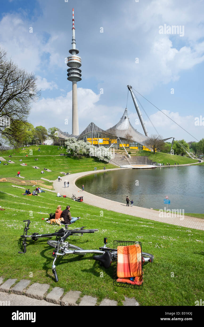 People outdoors in Spring weather at Olympic Park in Munich Bavaria Germany - Stock Image